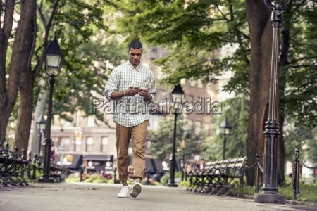 a man walking through a town