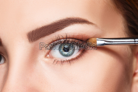beautiful female eyes with bright blue
