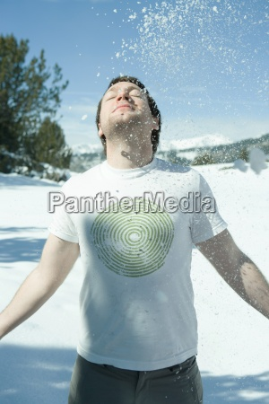 young man standing in snowy landscape