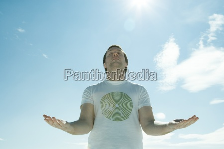 young man standing in the sun