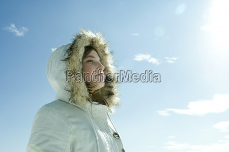 teen girl wearing parka low angle