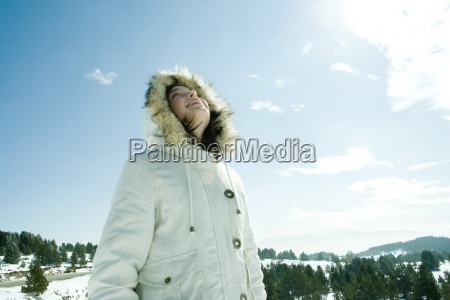 teen girl standing in snowy landscape