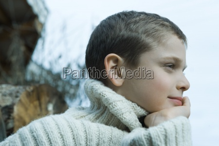 boy wearing wool sweater hand under