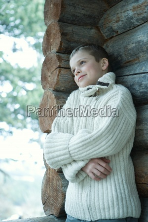 boy wearing wool sweater arms folded