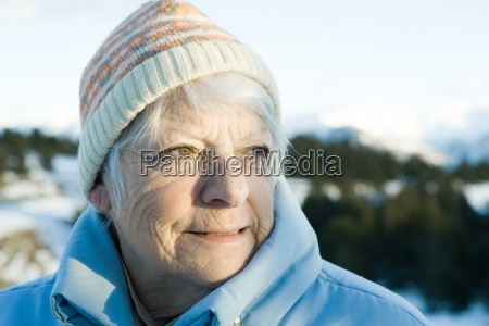 senior woman in snowy landscape head