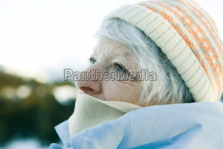 senior woman wearing knit hat and