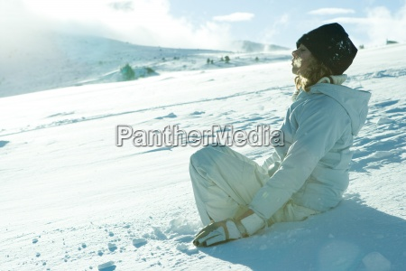 teen girl sitting on snow
