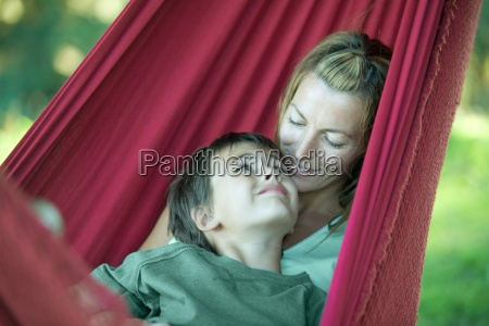 boy and mother in hammock smiling