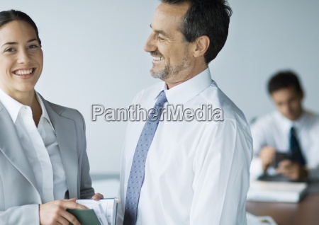 two business colleagues smiling