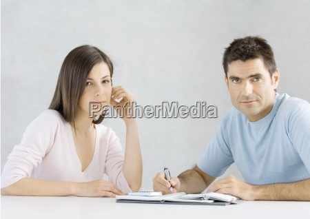 couple working on budget looking at