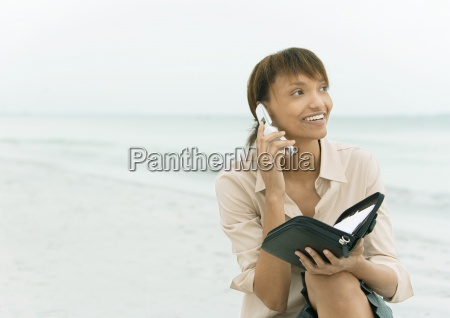 woman using cell phone and holding