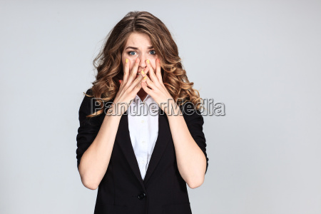 portrait of young woman with shocked