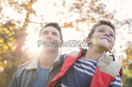 father in son below sunny autumn