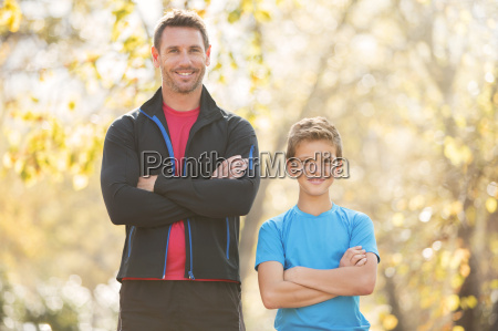 portrait confident father and son with