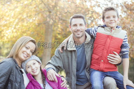 portrait smiling family in front of