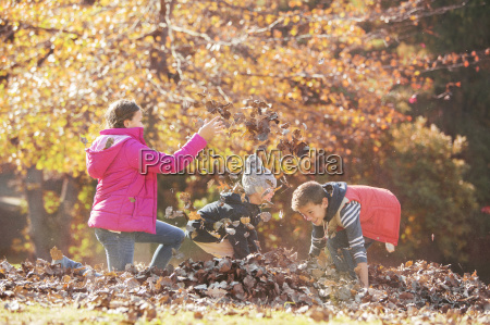 boys and girl playing in autumn