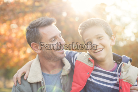 portrait smiling father and son in