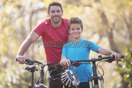 portrait father and son bike riding