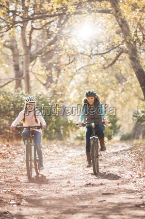 mother and daughter bike riding on
