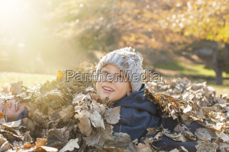 portrait smiling boys covered in autumn