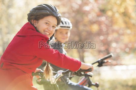portrait enthusiastic girl bike riding with
