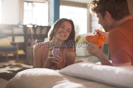 couple having breakfast in bed together