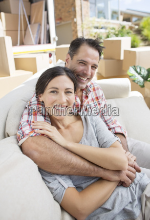 portrait of smiling couple hugging on
