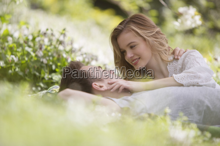 couple relaxing together in grass