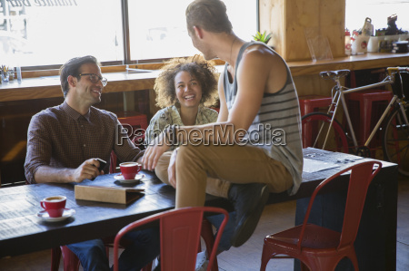 friends hanging out drinking coffee at