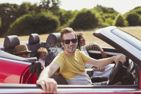 portrait smiling man in convertible with