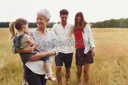 multi generation family walking in rural