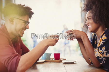 couple drinking coffee face to face