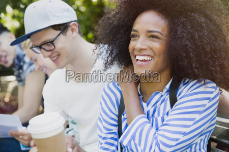 smiling woman with afro drinking coffee