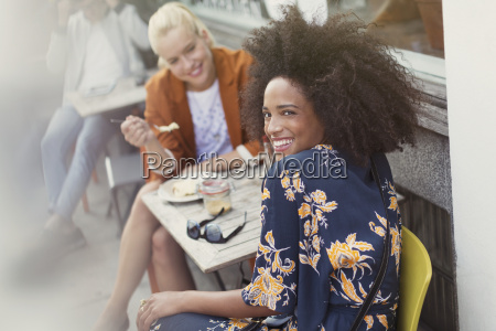 portrait smiling woman with friend at
