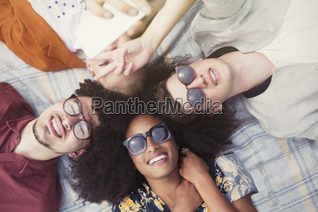 overhead portrait smiling friends laying in