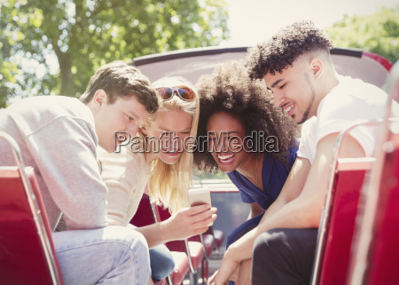 friends texting with cell phone on