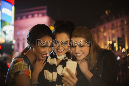 women talking picture together on city