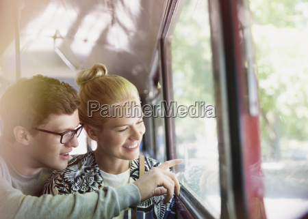 couple drawing on bus window