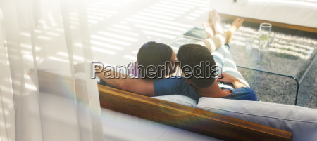 couple relaxing together on sofa in