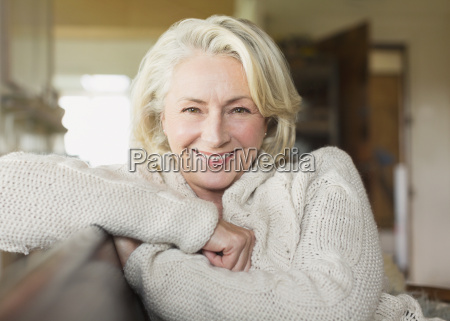 portrait smiling senior woman in sweater
