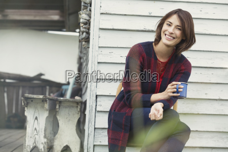 portrait smiling brunette woman drinking coffee