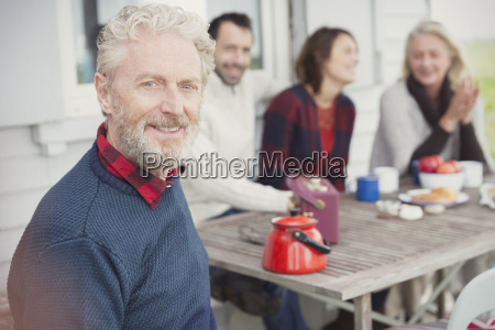 portrait smiling senior man enjoying breakfast