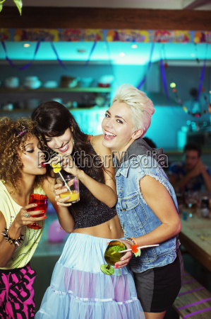 women enjoying cocktails at party