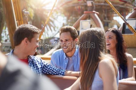 smiling friends talking on amusement park