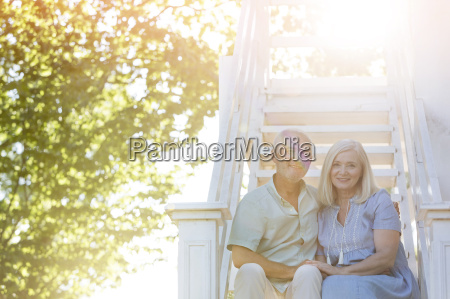 portrait smiling senior couple sitting on