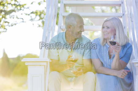 senior couple drinking wine on summer