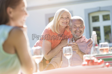 senior couple smiling and drinking wine