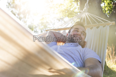 smiling young man relaxing in summer