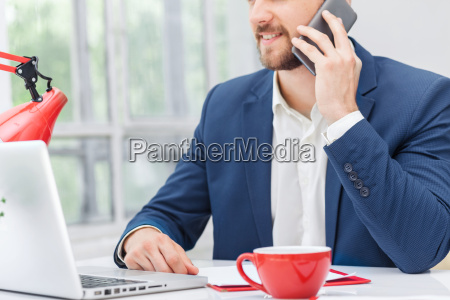 portrait of businessman talking on phone