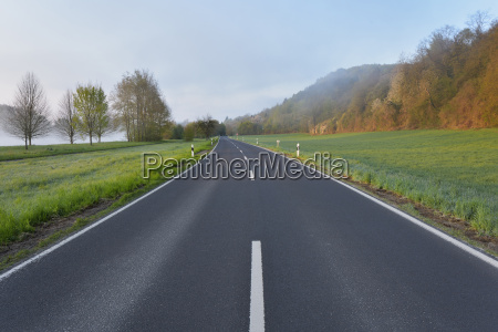 country road in morning himmelstadt main